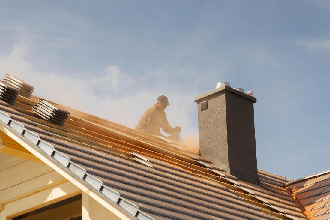 professional roofers working on roof replacement